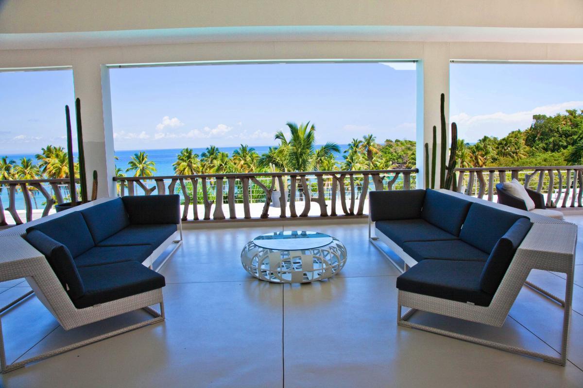 Location villa Las Terrenas - Le coin salon de la terrasse