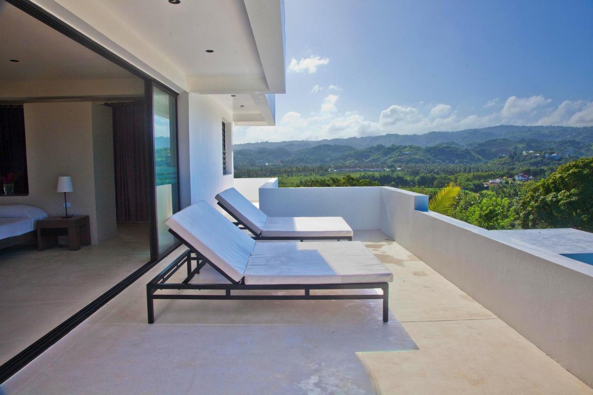 Location villa Las Terrenas - La terrasse de la suite de 80m² du niveau supérieur